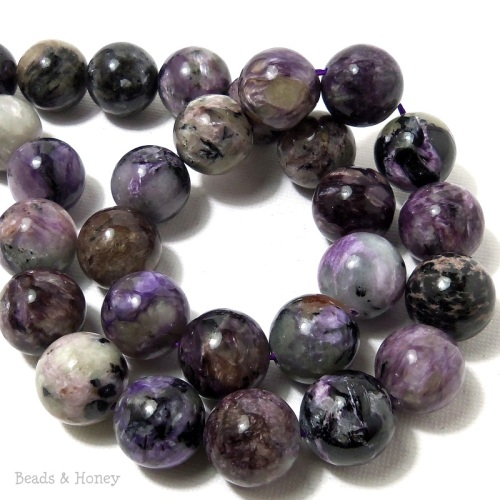 I'm having a hard time letting go of these Russian charoite lovelies - 15mm!