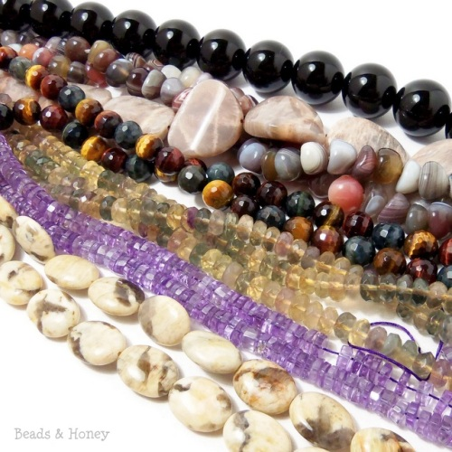 Graphic feldspar, amethyst, fluorite, multi colored tiger eye, botswana agate, moostone focals, and big black onyx rounds!